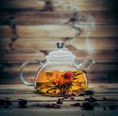 Glass teapot with blooming tea flower inside