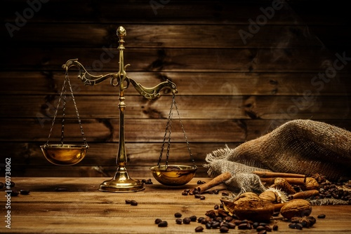 Coffee theme with brass scales still-life on wooden table