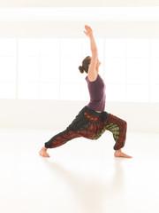 demonstration of stretching yoga posture