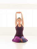 young woman in sitting yoga posture