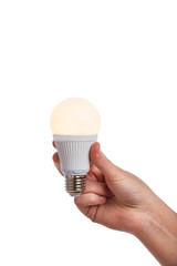 Hand holding bright led light bulb