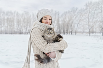 Woman with a cat in winter