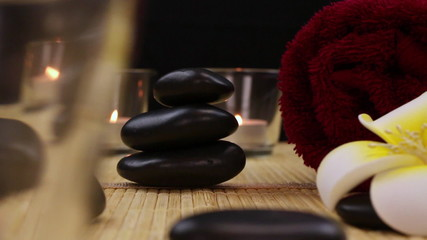 spa therapy stones surrounded by candles