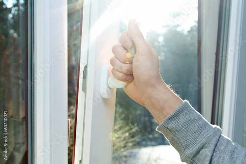 hand open window