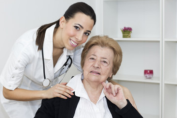 Young  nurse with senior woman