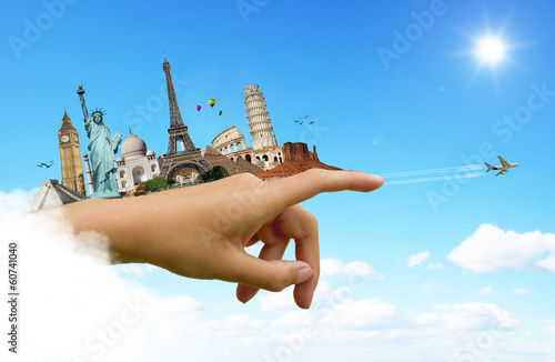 Travel the world monuments hand concept