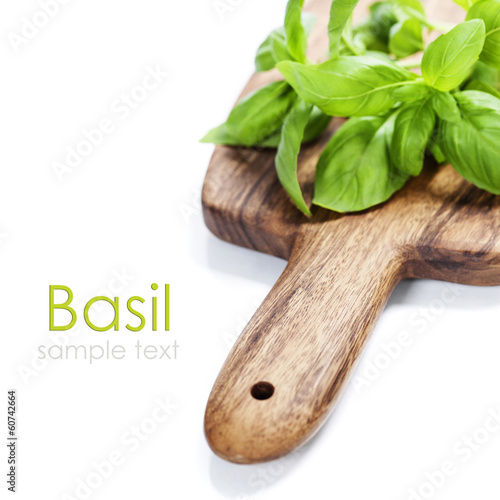 Fresh herbs on wooden chopping board