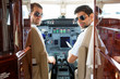 Confident Pilots In Cockpit Of Plane