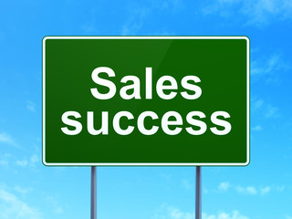 Marketing concept: Sales Success on road sign background