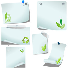 Blank pinned recycle memo papers on white