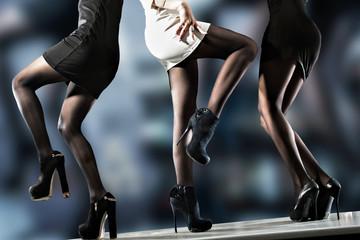 Ladies legs dancing on bar