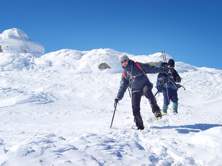 Climbers team on the snowy mountain. Sport concept