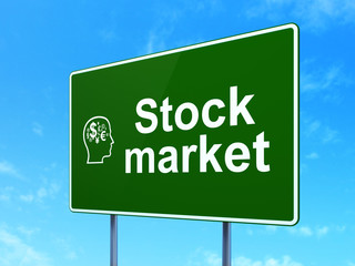 Finance concept: Stock Market and Head With Finance Symbol on