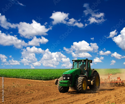 Tractor in the field. Agricultural composition