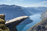 Fototapety female gymnast doing a handstand on trolltunga rock in norway