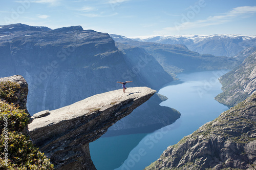female gymnast doing a handstand on trolltunga rock in norway