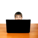 Surprised Teenager behind Laptop
