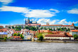 View of colorful old town and Prague castle with river
