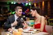 couple in restaurant toasting