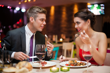 man and woman having a romantic meal