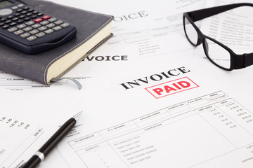 invoice and bills with paid stamp