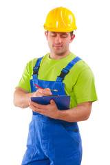 men wearing working clothes writing in clipboard
