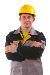 young worker with crossed arms isolated