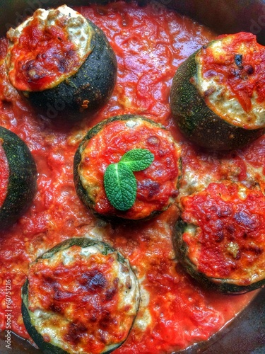 Stuffed rounded zucchini with tomato sauce