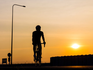 man biking on the road