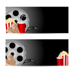 reel of film with popcorn and a drink on a black background.set