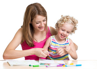 Happy mother and child painting together