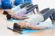 Fit class exercising at fitness studio - 60752295