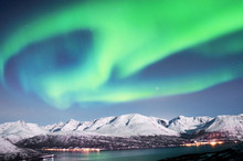 Northern lights above fjords in northern Norway.