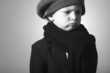 Sad Little Boy in Cap. Fashion Children. Handsome Child in Scurf