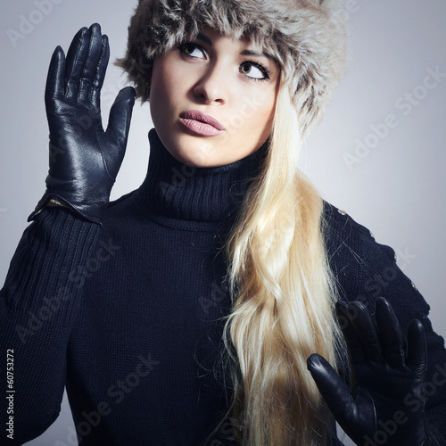 Girl in Fur Hat. Beautiful Blond Woman in Leather Gloves