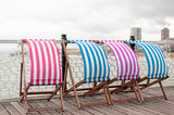 Colorful sunbeds at the seaside