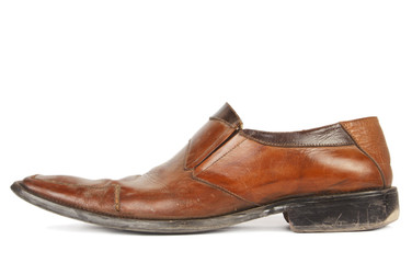 Used brown shoes isolated