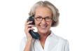 Senior lady attending phone call