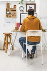 Modern creative man working on workspace.