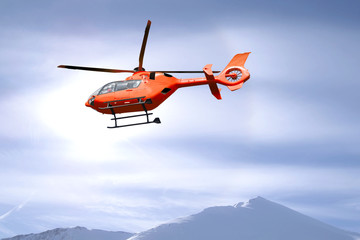 Rescue helicopter over mountain summits