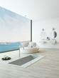 Modern floor bathtub against huge window with seascape view