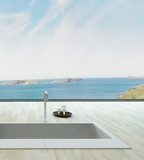 Fantastic floor bathtub against window with seascape view