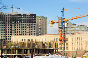 Construction site with crane, building
