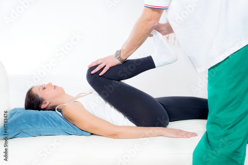 Chiropractor Works on the Patient Leg