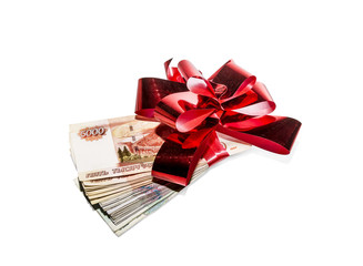 A bundle of banknotes tied up gift bow