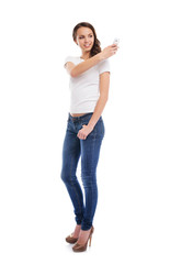 A young and attractive teenage girl with a mobile phone