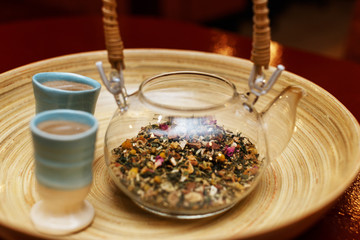 Healthy traditional herbal drink in a glass teapot