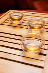 Three cups on a wooden tray