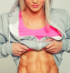 Blonde showing her trained ABS