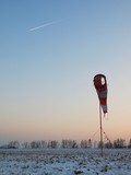 Abandoned winter airport wit windsock, evening blue sky